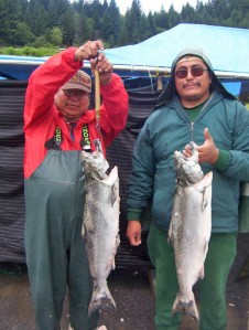 Native American fisherman with salmon catch