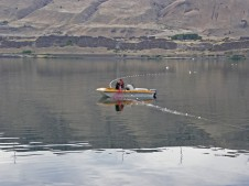 Fishers check their net on the Columbia River.