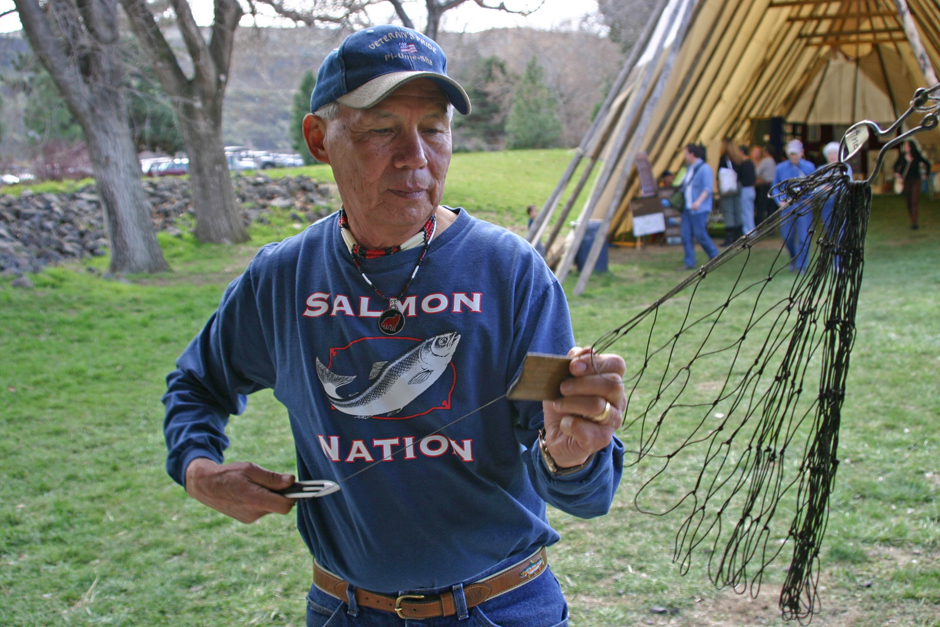 Warm Springs tribal elder Terry Courtney, Jr. demonstrating how to tie a net at the Celilo Falls Inundation 50th Anniversary Commemoration.
