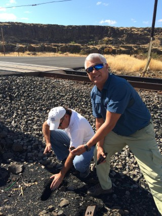 During the tour, Chip Smith (right), Assistant for Environment, Tribal and Regulatory Affairs, Office of Assistant Secretary for Army Civil Works; and JR Inglis, Corps of Engineers Tribal Liaison, Portland District, dug down to find the depth of the coal debris along the tracks. In some places, they found debris 4 to 6 inches deep.
